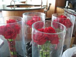 home made wedding center pieces with red roses.jpg