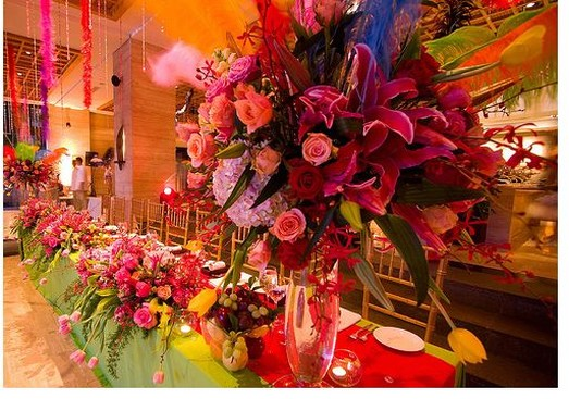 Tall wedding center piece with colorful flowers pictures.jpg