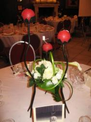 wedding center pieces candles in red and white flowers.jpg