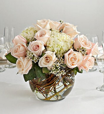 Wedding Centerpiece In Glass Bubble Bowl With Peach Roses And Wthite Flowers