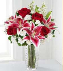 Colorful centerpiece with white flowers, dark roses and pink lilies flowers pic.JPG