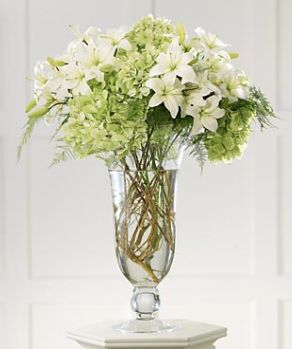 Modern white flower arrangements euffslemani grace altar wedding arrangement with white flowers and light green jpg mightylinksfo