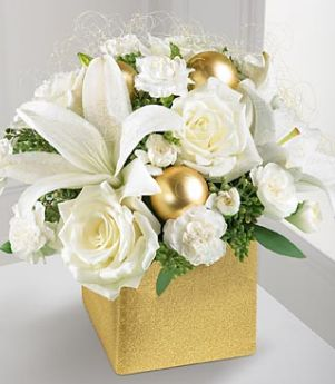 Pretty wedding arrangement with white flowers, green leaves and golden bliss picture.JPG