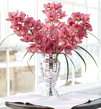 Image of Enchanting Pink Orchid arrangement with elegant silver vase.JPG