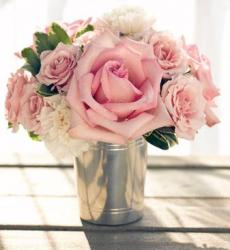 Light pink roses and cream flowers arrangement in silver vase picture.JPG