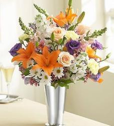 many different flowers arrangement in pretty silver vase.JPG