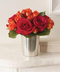 Martha Stewart arrangement with red and orange roses in silver vase photo.JPG