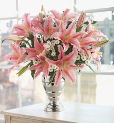 Oriental pink lily with small white flowers arrangement with elegant silver vase.JPG