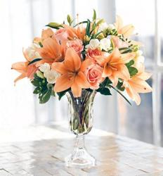 Peach arrangement with lily, peach roses and white flowers with glass vase picture.JPG