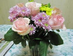 Peachy pink roses and purple and yellow flowers arrangement picture.JPG