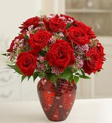 Photo of red roses arrangement with tiny pink flowers with crystal red vase with interesting patterns.JPG