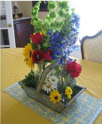 Pretty homemade with red, blue, yellow and white flowers with green leaves.JPG