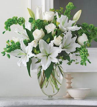 Pure white arrangement with lilies and white roses picture.JPG