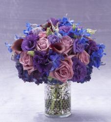 Purple and blue flowers arrangement with elegant vase glass picture.JPG