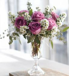 Purple roses and small white flowers arrangement with tall glass vase photos.JPG