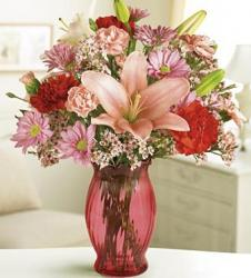 Red and pink passion arrangement in red vase image.JPG