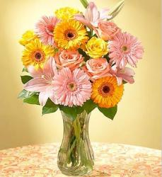 Yellow and peach flowers arrangement  with glass vase.JPG