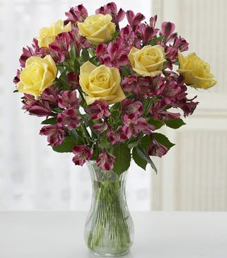 Yellow Rose and Purple Peruvian Lilies arrangement with glass vase picture.JPG