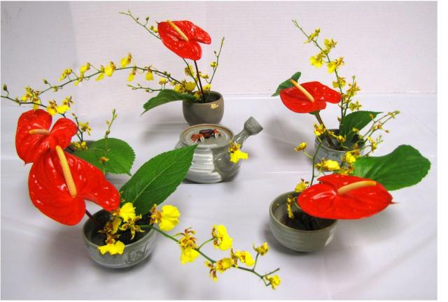 Beautiful Japanese arrangements with red and yellow flowers and green leaves.JPG