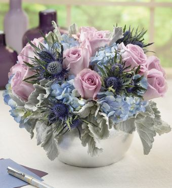 Blue purple arrangement with silver vase.JPG
