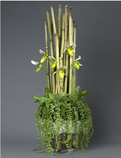 Cool Tall And Green Arrangement With Small White Flowers