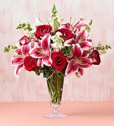 Dark pink and white lily and red roses arrangement in glass vase picture.JPG